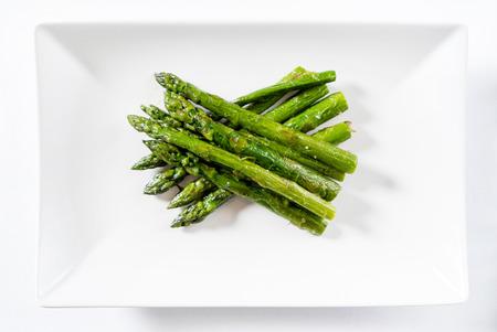 roasted asparagus on white plate Stockfoto