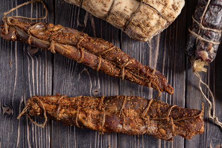 dried meat on the wooden background Imagens