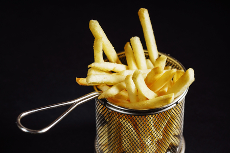french fries on black background Stock Photo