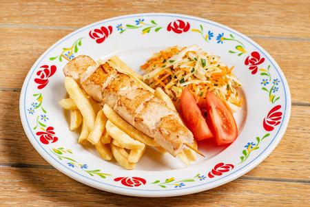 chicken kebab with french fries Standard-Bild - 101811982