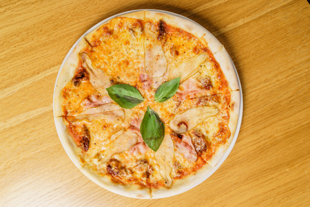 tasty pizza on the table Banco de Imagens