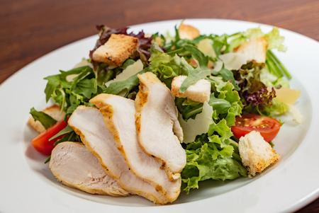 Caesar salad with chicken Фото со стока