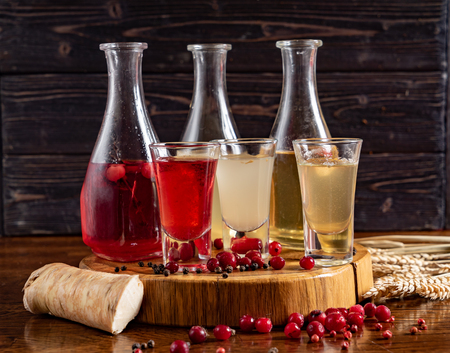 berry tincture on table Stock Photo
