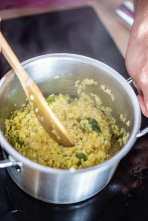 chef making risotto