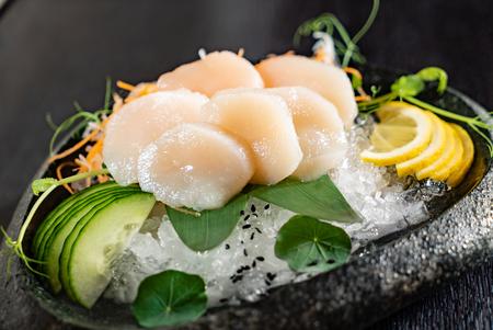 scallop sashimi on ice Imagens