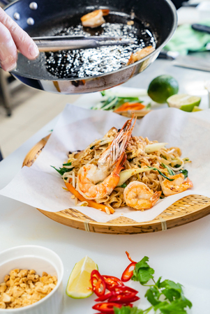 chef making seafood noodles Stock Photo