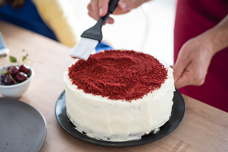 chef making red velvet cake