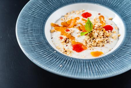 Oat porridge with fruits 写真素材