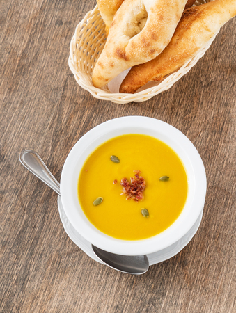 Pumpkin cream soup on the table Stock Photo