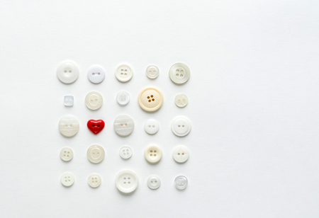 white buttons with red heart Stock Photo