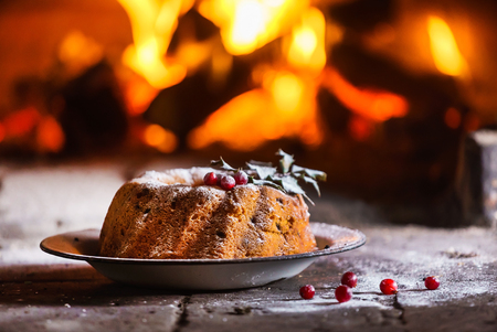Christmas cake near fireplace Stock Photo