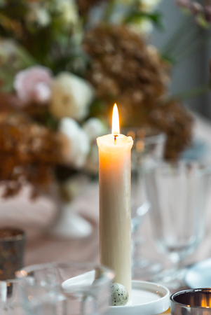 Easter table with candle Stock Photo