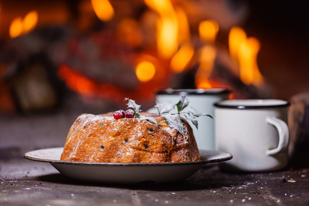 Christmas cake near fireplace Stockfoto