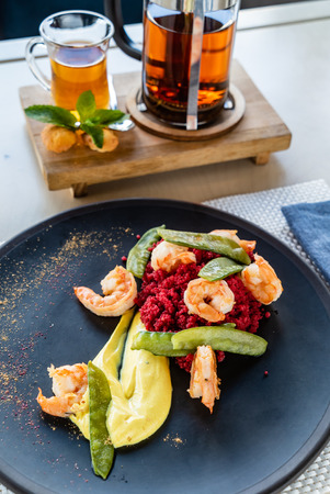 millet with beetroot and shrimps Stock Photo