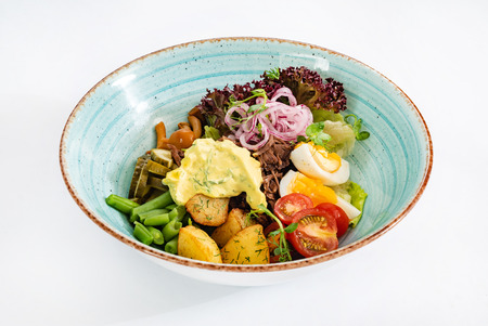 vegetable salad on blue bowl