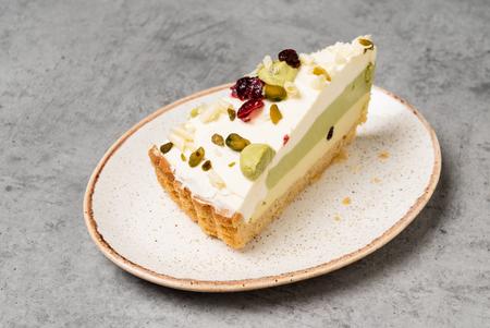 cheesecake with pistachio Imagens
