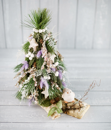 Christmas tree on the wood background