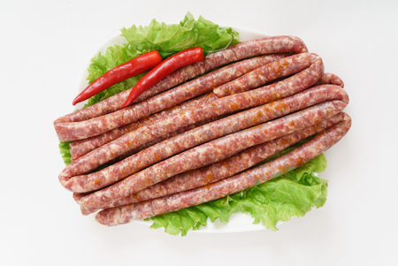 raw sausages with chilli pepper Stock fotó