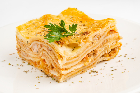 meat lasagna on the white background Imagens