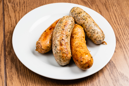 sausages on the white plate