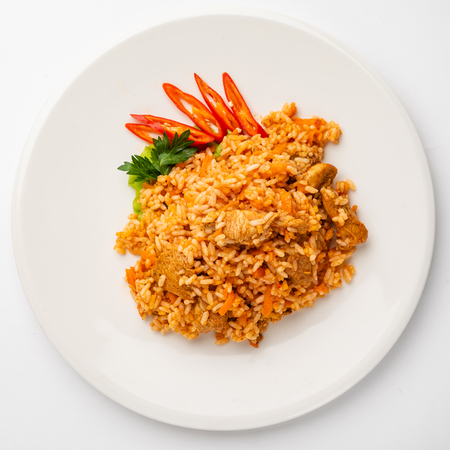 rice pilaf with meat, carrot and onion isolated on white background