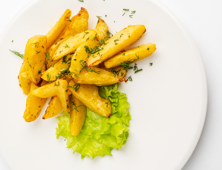 fried potatoes on the white plate