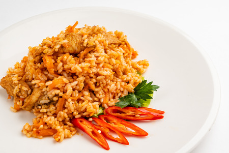 Rice pilaf with meat, carrot and onion isolated on white