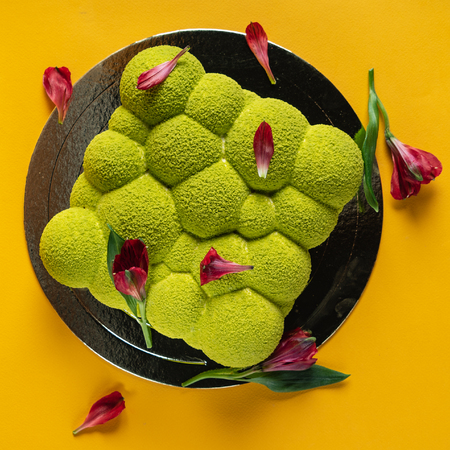 Creative cake with flower petals 写真素材