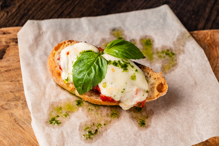 Traditional italian bruschetta with cherry tomatoes, cream cheese, basil leaves 스톡 콘텐츠