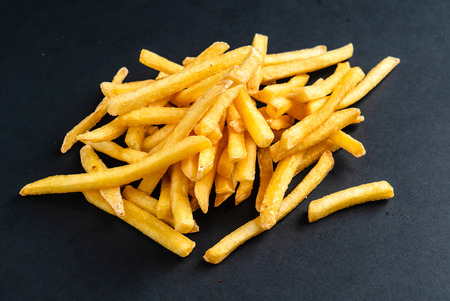 french fries on the black background