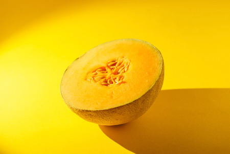 Cantaloupe on yellow background