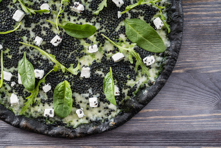pizza with black caviar