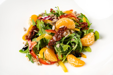 fresh salad with arugula, tomato, pepper and mandarin. - Image Imagens