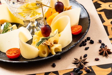 Cheese plate on the black table -  Image