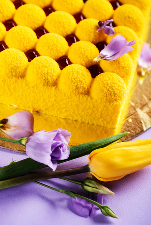 Yellow Easter cake with flowers