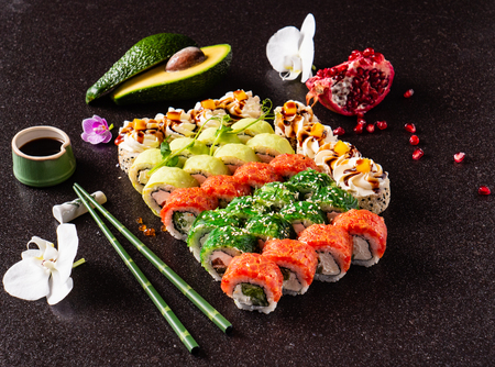 Rainbow Sushi set with salmon, eel, tuna, avocado, royal prawn, cream cheese Philadelphia, caviar tobica, chuka. Sushi menu. Japanese food 스톡 콘텐츠 - 115205325