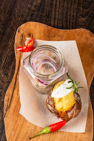 roasted potato with herring Фото со стока