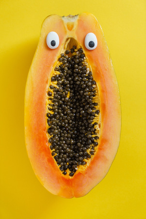 funny papaya on the yellow background