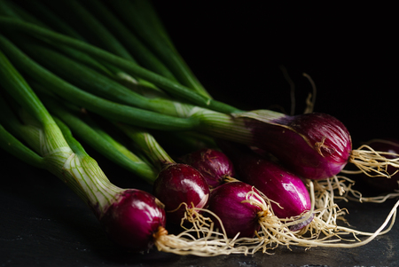 onion bulbs on the black background