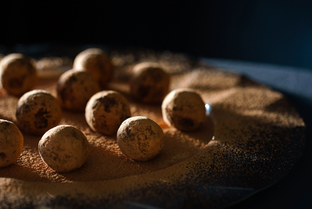 sweet chocolate truffles on the black background