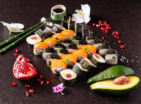 Rainbow Sushi set with salmon, eel, tuna, avocado, royal prawn, cream cheese Philadelphia, caviar tobica, chuka. Sushi menu. Japanese food Stock Photo