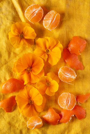 orange primroses and fruits on the orange linen fabric