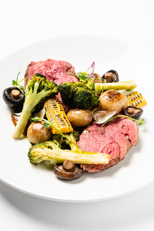 Spicy Beef Slices Meat  with broccoli, corn and mushrooms. Creative and gourmet food Archivio Fotografico - 116102706