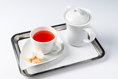 Red tea cup and teapot on the white background