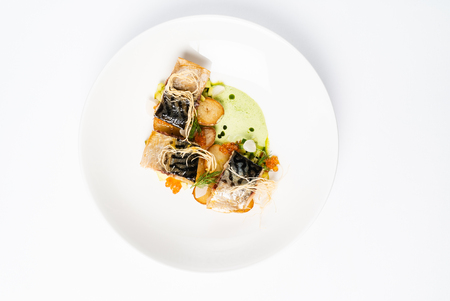 plate with delicious grilled mackerel with vegetables and green pea puree