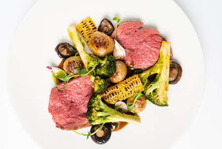 Spicy Beef Slices Meat  with broccoli, corn and mushrooms. Creative and gourmet food Archivio Fotografico - 116102915