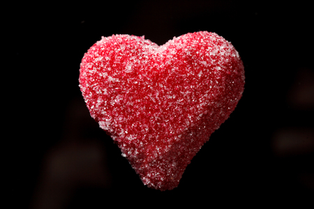 Marzipan heart on the black background Stock Photo