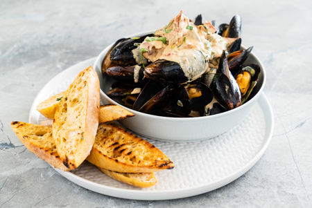 Mussels with herbs in a bowl