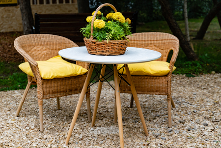 withy garden table and chairs with pillows