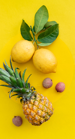 Fresh ripe exotic fruits with leaves on the yellow